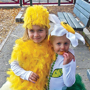 Clio the Daisy and Vienna the Chick stealing hearts at the 10th Annual Pumpkin Stroll on Sunday.