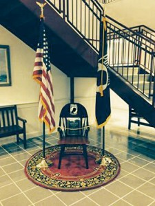A chair commemorating military service members who are missing in action or have been taken as prisoners of war will be installed in City Hall Friday, Nov. 8 at noon.