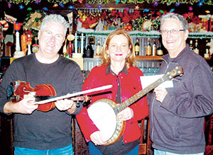 The Burren's Tommy McCarthy and Louise Costello (left, center) performed their enchanting Celtic music at thier album release party, earning SHC over $3000.