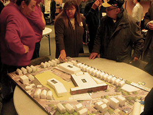 A model of the property being developed by Tufts, which includes the TAB on Holland Street and the site of the current Powder House School on Broadway.