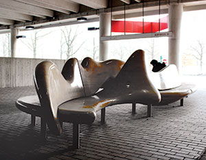 Alewife Station: Maple, stainless steel sculptural bench (1 of 2) done by William Keyser, Jr.