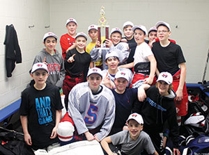 The 2014 Somerville Youth Hockey Middle School Team, post game, celebrating their Valley League Championship win in the locker room. Front row lying down, Ryan Vogel. 2nd row kneeling, left to right, Chris Desousa, C.J. Resmini, Nolan Roche, Gus Hawkins. 3rd row, left to right, Nathan Herra-Valente, Sean Sullivan, Anthony Parziale, Shayne Murphy, Jake Gunther. Back row, left to right, Jason Cassidy, Dylan Zraket, Derek Doane, Bobby Lavey and Brandon Lafee.