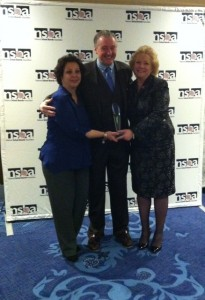 National School Boards Association President David Pickler presents the Shannon  Award for Excellence to MA Association of School Committees 2014 President Ann  Marie Cugno of Medford (left) and MA Association of School Committees 2013  President Mary Jo Rossetti of Somerville (right).