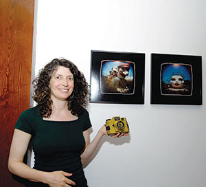 Michelle Bates shows off her toy camera works of art.
