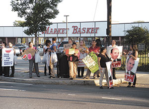 Demonstrators held their ground at the Somerville Avenue Market Basket store in support of ousted CEO Arthur T. Demoulas. ~Photo by Donald Norton