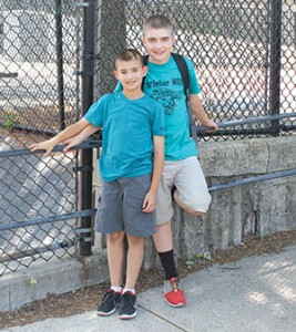 (L to R) Brady Sullivan and Sean Sullivan, on their last day of school, in front of Winter Hill Community Innovation School.