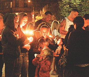 Friends and family members of drug abuse victims gathered seek understanding and healing at Somerville Overcoming Addiction's candlelight vigil held at Somerville High School last week