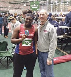 Gabrielle Etienne with her 2nd place medal in the Shot Put along with Coach Carl Stauffer.
