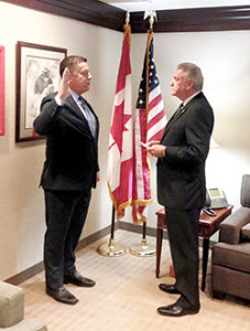Colbert, left, was sworn in as 3rd district Vice President by IAFF President Harold Schaitberger.