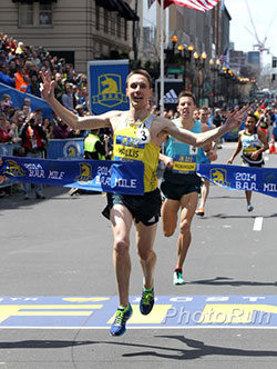Nick Willis winning the B.A.A. Invitational Mile in Boston in 2014. ~Photo by PhotoRun.net