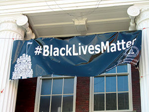 "Local police union representatives are openly challenging the City of Somerville to remove the ""Black Lives Matter"" banner hanging at City Hall."