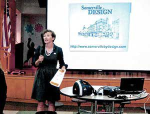 Office of Strategic Planning and Community Development Senior Planner Melissa Woods and others filled Ward 4 residents in on details of the city's proposed revitalization plan.