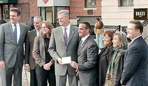 Massachusetts Governor Charlie Baker presented Somerville Mayor Joseph Curtatone with a 13M MassWorks Infrastructure grant for Union Square last week.