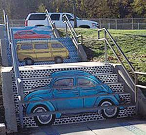 """The Souls Journey as A Series of Weird Old Cars"" street mural by Liz LaManche."