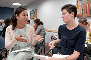 Eunice Kwon (left) and Colleen Morrissey discuss experiences with ageism, during a recent forum at Somerville-Cambridge Elder Services about age discrimination and cultural perceptions of aging.